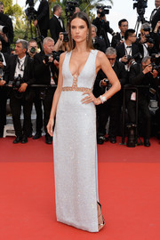 Alessandra Ambrosio sizzled on the Cannes red carpet in a cleavage-baring, crystal-encrusted gown by Michael Kors during the premiere of 'The Unknown Girl.'
