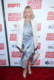 Naomi Watts accessorized with a pair of silver cross-strap peep-toes for added shimmer.