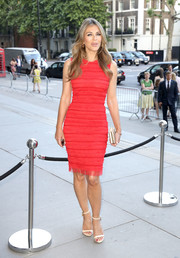 Elizabeth Hurley defied age in a body-con red dress by Givenchy at the V&A summer party.