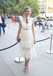Donna Air oozed sweetness at the V&A summer party wearing this white Three Floor broderie anglaise dress with ruffle detailing and a midriff cutout.