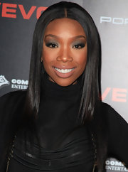 Singer Brandy attended a Hollywood event showing off her sultry metallic smoky eyes. She completed her look with a glossy nude lip.