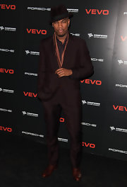 Ne-Yo is styling in this deep brown suit with a fedora and sash.