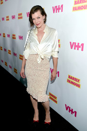 Milla Jovovich made an appearance at the 'Barely Famous' season 2 party wearing a white silk button-down tied at the waist.