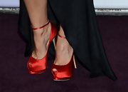 Elisha Cuthbert added a pop of color to her black gown with a pair of red satin peep-toe pumps.