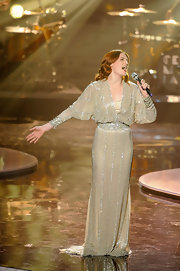 Florence Welch looked exquisite on stage in a beaded ivory gown for the Divas show.