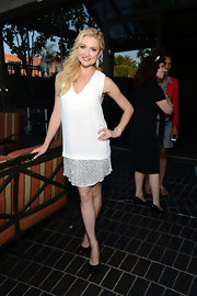 Katherine Bailess chose this free-flowing white dress with a silver underlay.