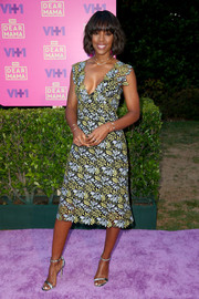 Kelly Rowland paired her lovely dress with silver ankle-strap sandals.