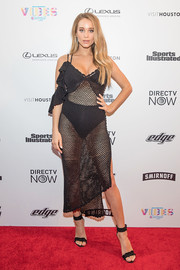 Hannah Jeter chose a pair of black ankle-cuff sandals to finish off her look.