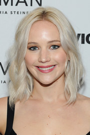 Jennifer Lawrence looked like a doll with her platinum-blonde waves at the New York premiere of 'Woman.'