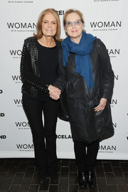 Meryl Streep arrived for the New York premiere of 'Woman' all bundled up in a black leather coat and a blue scarf.