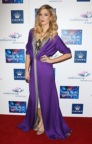 Delta Goodrem cut a regal figure in a purple and gray evening dress at the VRC Oaks Club luncheon.