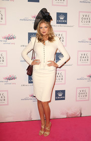 Kate Upton showed her more conservative side in a white Nina Ricci skirt suit with a peplum waist during the VRC Oaks Club luncheon.