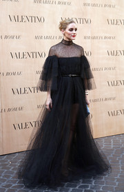 Olivia Palermo was an absolute stunner at the Valentino fashion show in a floaty black tulle gown from the label.