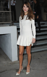 Caroline paired her long sleeve dress with studded pumps.