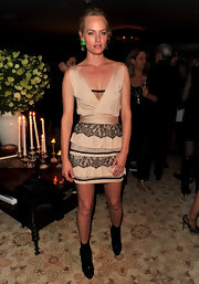 Model Amber Valetta showed off her svelte figure while attending the Valentino party in this lace embellished dress.