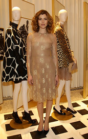 Vittoria Puccini looked divine in this delicate gold lace dress at a Valentino Flagship Store Opening in Milan.