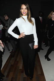 Jessica Alba took paired a classic white blouse with black slacks for a trendy black and white look.