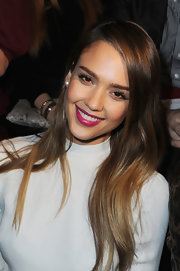 Jessica Alba's hot pink lips gave the actress a splash of color at the Valentino runway show in Paris.