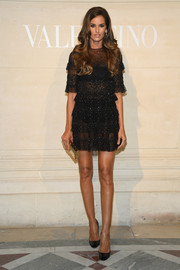 Izabel Goulart brought some sex appeal to the Valentino Couture Spring 2019 show with this sheer LBD from the brand.