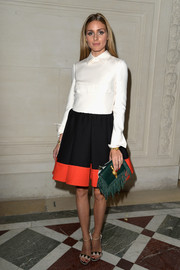 Olivia Palermo added another layer of color via a fringed green leather purse by Valentino.
