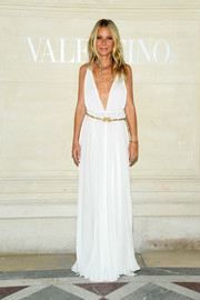 Gwyneth Paltrow was a vision in a plunging white Grecian gown by Valentino during the brand's Couture Fall 2019 show.