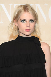 Lucy Boynton finished off her beauty look with a swipe of pink lipstick.