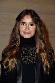 Miroslava Duma went boho with this wavy hairstyle with center-parted bangs at the Valentino Couture fashion show.