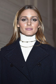 Olivia Palermo attended the Valentino Haute Couture show wearing her signature center-parted style.