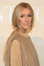 Celine Dion finished off her look with a pair of gemstone chandelier earrings.