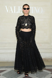 Clotilde Courau matched her top with a black lace maxi skirt.