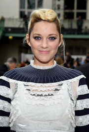 Marion Cotillard styled her hair into a punky pompadour for the Valentino Spring 2018 show.