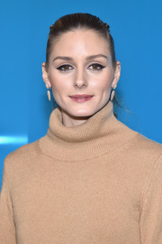 Olivia Palermo sported a slicked-back ponytail at the Valentino fashion show.
