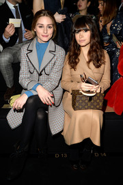Miroslava Duma opted for a simple yet classic tan wool coat when she attended the Valentino fashion show.