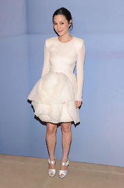 China Chow accessorized her full-skirted white frock with white satin strappy sandals.