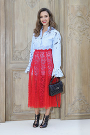 Jessica Alba attended the Valentino fashion show wearing an oversized blue button-down from the label's Resort 2017 collection.