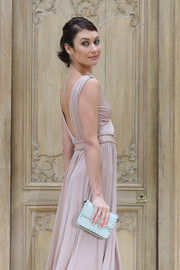 Olga Kurylenko arrived for the Valentino fashion show carrying a pastel-blue Rockstud bag from the label.