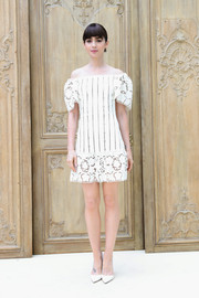Lily Collins took our breath away with this lacy white off-the-shoulder dress at the Valentino fashion show.