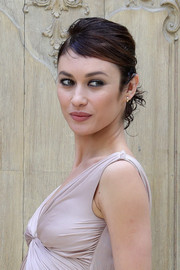 Olga Kurylenko pulled her short curls back into a loose ponytail for the Valentino fashion show.