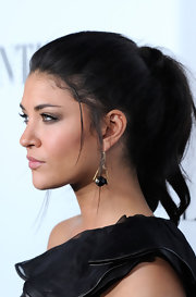 Jessica Szohr arrived for the opening of the Valentino flagship store in Beverly Hills wearing her long hair in a wrapped ponytail with loose face-framing strands.