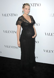Molly Sims was glowing in this black lace dress at the Valentino Rodeo Drive store opening.