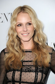 Monet Mazur wore her golden hair in long flowing waves at the opening of the Valentino flagship store in Beverly Hills.