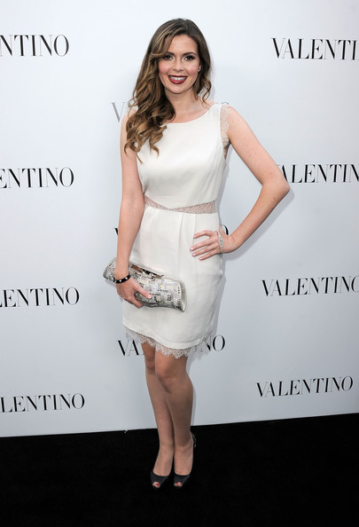 Carly Steel carried this unique clutch with her white lace cutout dress at the Valentino store launch.