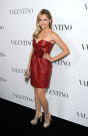 Teresa Palmer wore this rich burnt rose leather dress to the Valentino store opening in Beverly Hills.