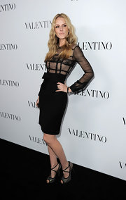 Monet Mazur arrived at the opening of the Valentino flagship store opening in Beverly Hills wearing a pair of strappy suede and crystal heels.
