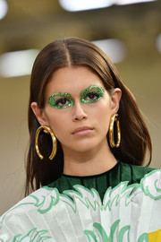 Kaia Gerber looked festive with her green glitter eyeshadow.