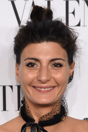 Giovanna Battaglia topped off her look with a quirky, messy top knot when she attended the Valentino Sala Bianca 945 event.