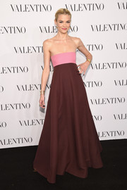 Jaime King donned a fun yet sophisticated color-block strapless gown by Valentino for the Sala Bianca 945 event.