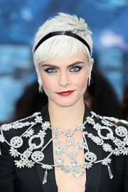 Cara Delevingne amped up the cuteness with a black satin headband.