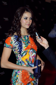 Nina Dobrev went all out with the colors during the 'Vampire Diaries' 100th episode celebration, pairing a blue Amanda Pearl tube clutch with a vibrant beaded dress.