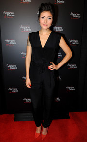 Daniella Pineda chose a simple yet stylish black jumpsuit for her red carpet look during the 'Vampire Diaries' 100th episode celebration.